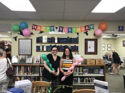 Library Director, Natalie Hurteau and Head Librarian Sara Hopkins celebrate the Library's 30 years
